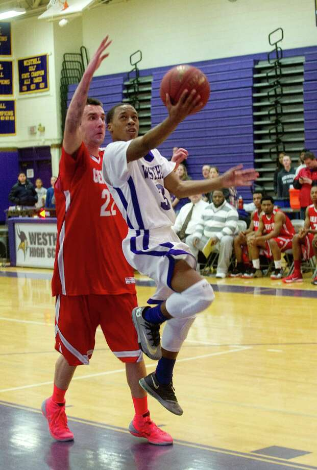 Westhill's CJ Donaldson puts up a shot against Bridgeport Central during Friday's basketball game at Westhill High School on January 31, 2014. Photo: Lindsay Perry / Stamford Advocate