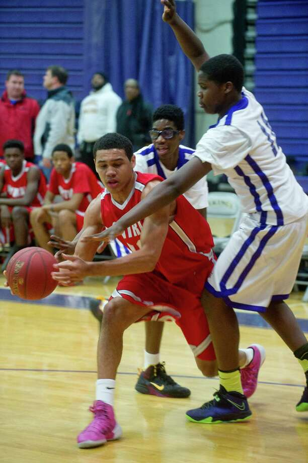 Bridgeport Central's Marcus Blackwell controls the ball during Friday's basketball game at Westhill High School on January 31, 2014. Photo: Lindsay Perry / Stamford Advocate