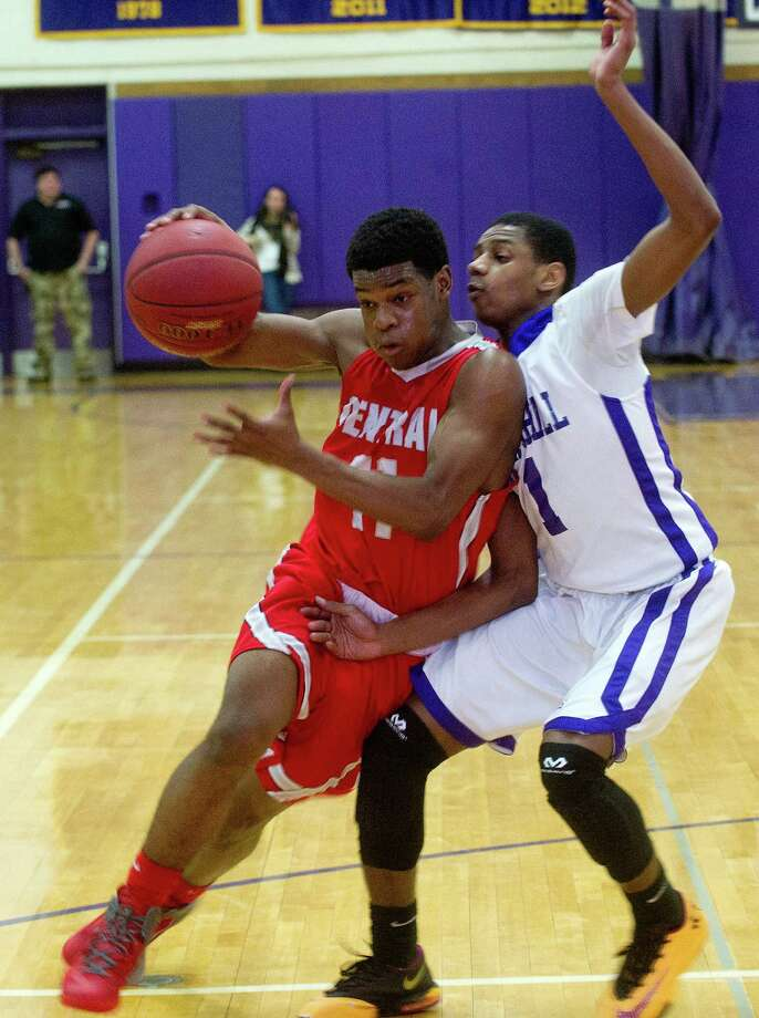Bridgeport Central's Tyler Ancrum controls the ball as he is guarded by Westhill's Jeremiah Livingston during Friday's basketball game at Westhill High School on January 31, 2014. Photo: Lindsay Perry / Stamford Advocate