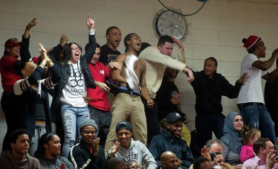 Bridgeport Central fans cheer for their team during Friday's basketball game at Westhill High School on January 31, 2014. Photo: Lindsay Perry / Stamford Advocate