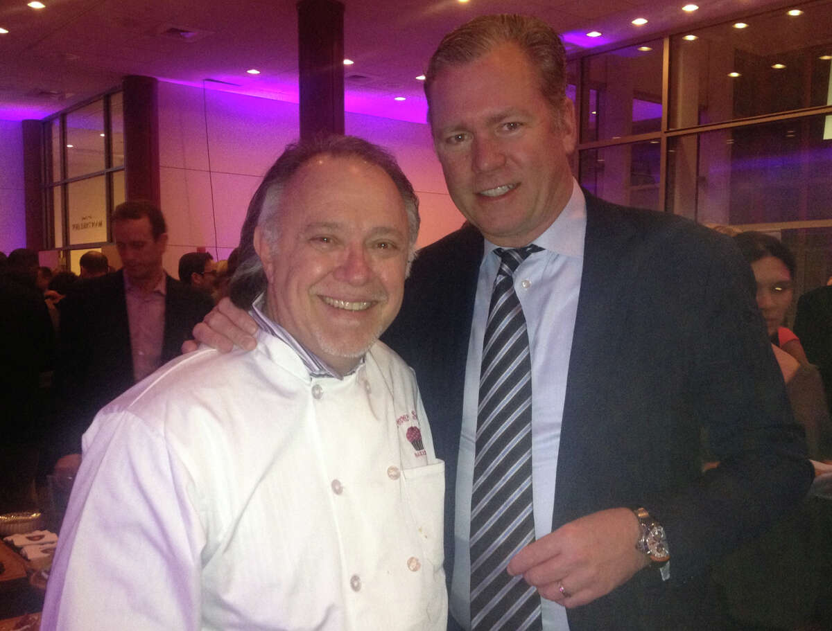 Sky Mercede, of Forever Sweet Bakery in Norwalk, and Stamford resident and TV journallist Chris Hansen at Stamford Family YMCA 2nd Annual Fine Food for a Cause at The Palace Theatre last week.