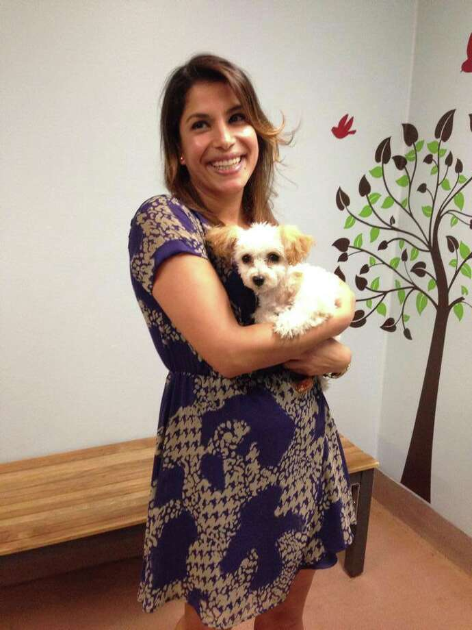 New owner Patricia Aleman cuddles with Gem. Photo: Courtesy, Animal Care & Control