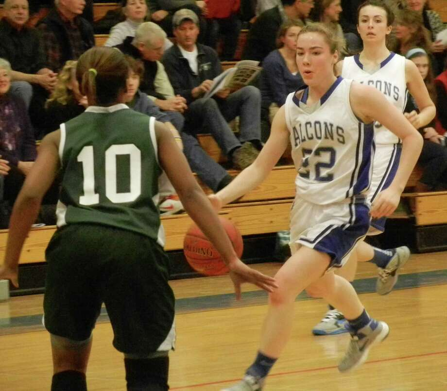 Fairfield Ludlowe sophomore point guard Regan Steed dribbles against Norwalk's Jacquieline Harris wth Falcons' teammate Julia Pangallo to the right on Fridayl, Jan. 31 in Ludlowe's 63-44 FCIAC girls basketball victory over the Bears in Fairfield. Photo: Reid L. Walmark / Fairfield Citizen
