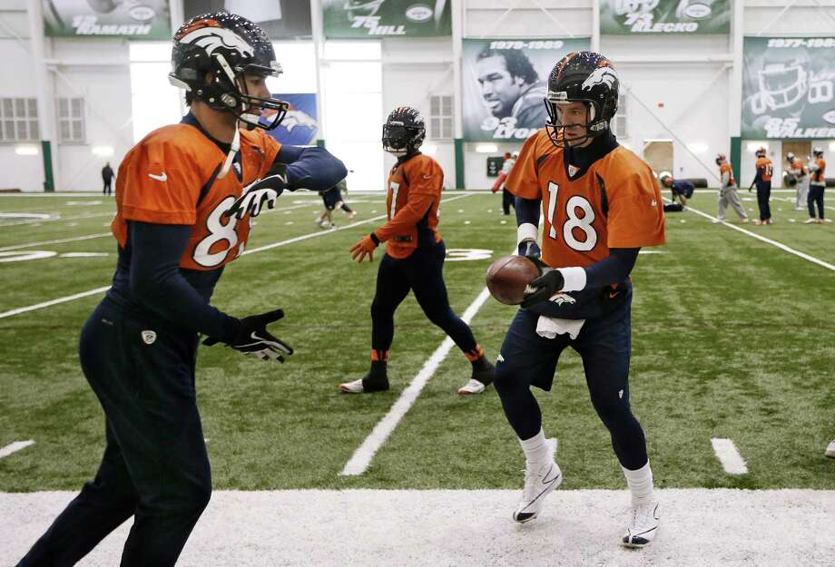 Denver Broncos quarterback Peyton Manning (18) hands the ball off to wide receiver Eric Decker (87) during practice Friday, Jan. 31, 2014, in Florham Park, N.J. The Broncos are scheduled to play the Seattle Seahawks in the NFL Super Bowl XLVIII football game Sunday, Feb. 2, in East Rutherford, N.J. (AP Photo/Mark Humphrey) ORG XMIT: NJMH109 Photo: Mark Humphrey / AP
