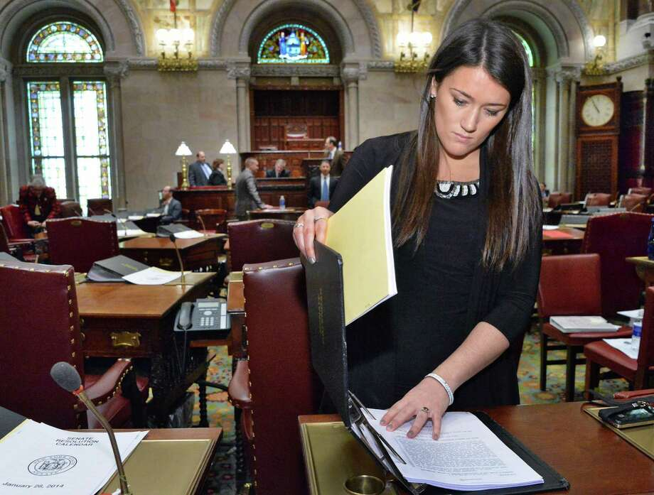 NYS Senate aide Molly Marcy in the Senate Chambers Tuesday Jan. 28, 2014, in Albany, NY. Marcy is the third generation of women in her family to work in politics.  (John Carl D'Annibale / Times Union) Photo: John Carl D'Annibale / 00025519A