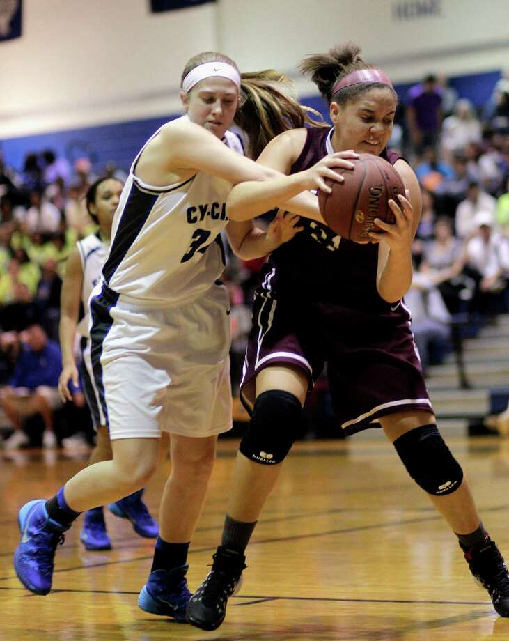 Cy-Fair's Shania Woods (21) grabs the ball from Cy-Creeks' Jessica Munoz in the first half Friday, January 31, 2014. Photo: Bob Levey / ©2014 Bob Levey