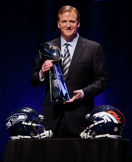 NFL comissioner Roger Goodell holds the Vince Lombardi Trophy at a news conference Friday, Jan. 31, 2014, in New York. The Seattle Seahawks are scheduled to play the Denver Broncos in the NFL Super Bowl XLVIII football game on Sunday, Feb. 2, at MetLife Stadium in East Rutherford, N.J. (AP Photo/Matt Slocum) Photo: Matt Slocum, STF / AP