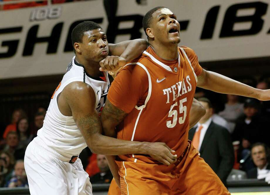 Center Cameron Ridley has been a force inside for Texas this season, averaging 11.2 points, 7.8 points and 2.4 blocks. Photo: Sue Ogrocki, STF / AP