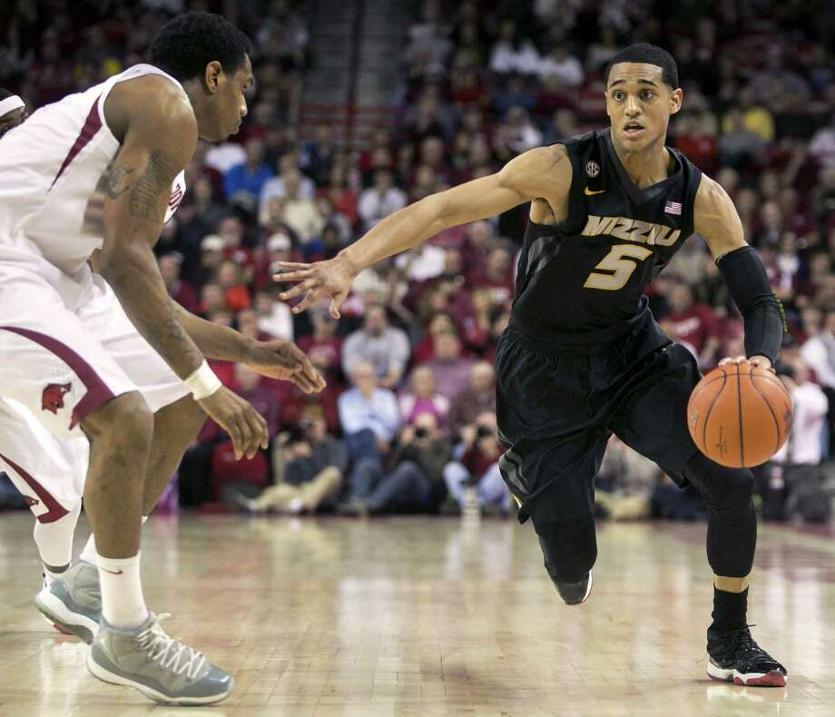 Missouri point guard Jordan Clarkson (right) is averaging 18.5 points and 3.5 assists per game this season. The former Wagner High standout had to wait 20 months to play college basketball again after transferring from Tulsa. Photo: Gareth Patterson / Associated Press / FR170364 AP