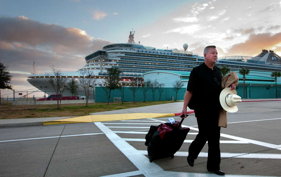 Jack Doebbler leaves the Caribbean Princess on Friday. The ship returned early with norovirus reported on board. Photo: Cody Duty, Staff / © 2014 Houston Chronicle