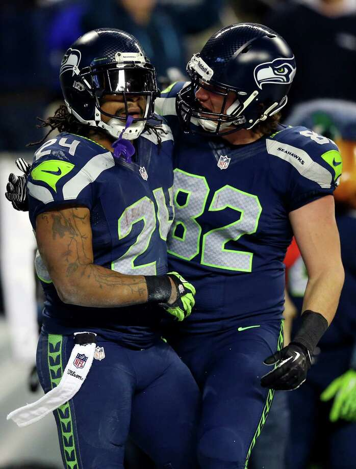 Luke Willson, right, a former Rice tight end, celebrates with Marshawn Lynch after a Lynch TD. Photo: Ronald Martinez, Staff / 2014 Getty Images