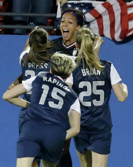U.S. forward Sydney Leroux, center, shows her excitement after scoring the lone goal against Canada. Photo: LM Otero, STF / AP