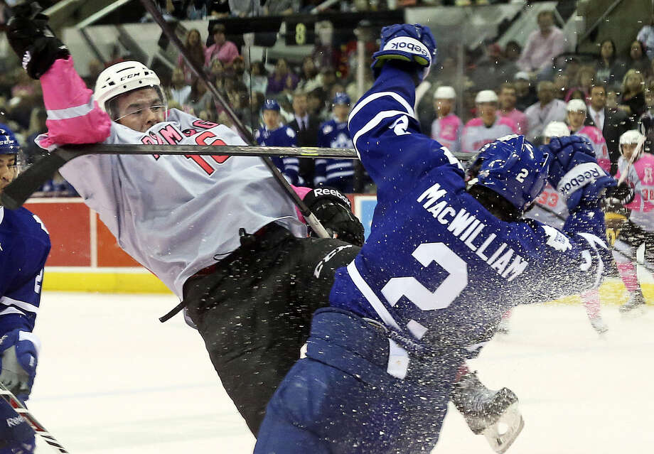 The Rampage's Bobby Butler (left) crashes into Toronto's Andrew MacWilliam as the two battle for the puck during Pink in the Rink Night at the AT&T Center. Photo: Tom Reel / San Antonio Express-News