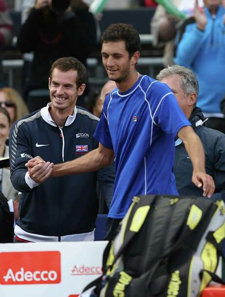 James Ward, center, earns a handshake from teammate Andy Murray after his Davis Cup comeback. Photo: Clive Brunskill, Staff / 2014 Getty Images