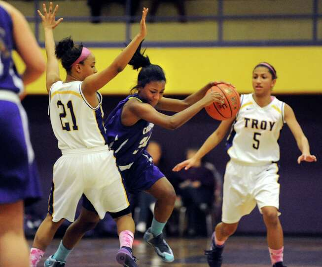 Catholic Central's Atoria Elem, center, controls the ball as Troy's Alliyah Gillespie, left, and Sha