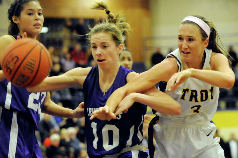 Catholic Central's Julia Engster, left, and Troy's Mary Pattison battle for a loose ball during their basketball game on Friday, Jan. 31, 2014, at Troy High in Troy, N.Y. (Cindy Schultz / Times Union) Photo: Cindy Schultz / 10025582A