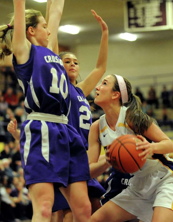 Troy's Mary Pattison, right, looks for room to shoot as Catholic Central's Julia Engster, left, and Nakaela Elliot defend during their basketball game on Friday, Jan. 31, 2014, at Troy High in Troy, N.Y. (Cindy Schultz / Times Union) Photo: Cindy Schultz / 10025582A