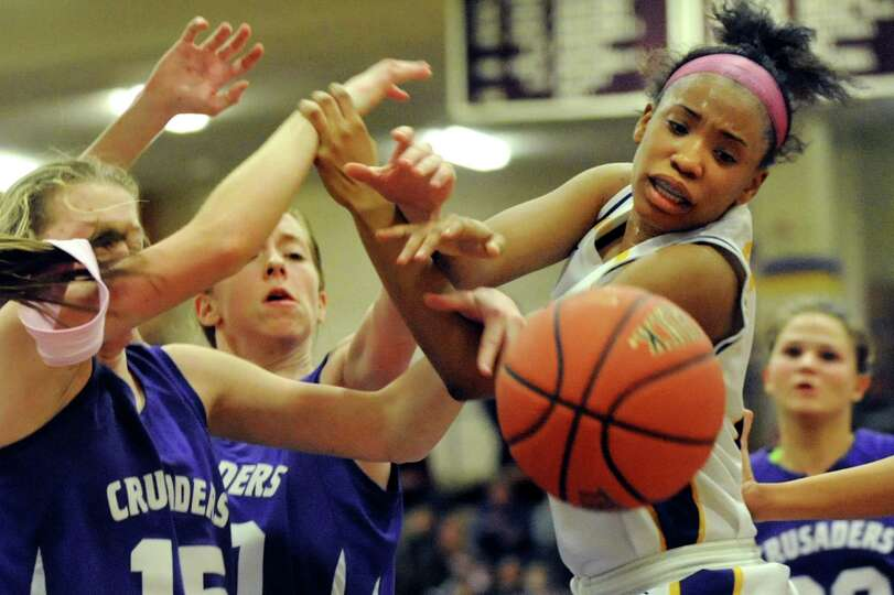 Troy's Alliyah Gillespie, right, fights for a loose ball during their basketball game against Cathol