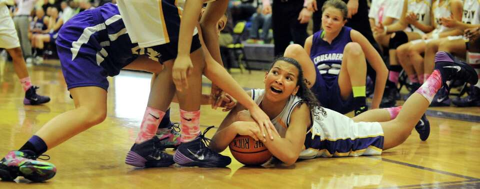 Troy's Kiana Patterson, right, fights to keep a loose ball during their basketball game against Cath