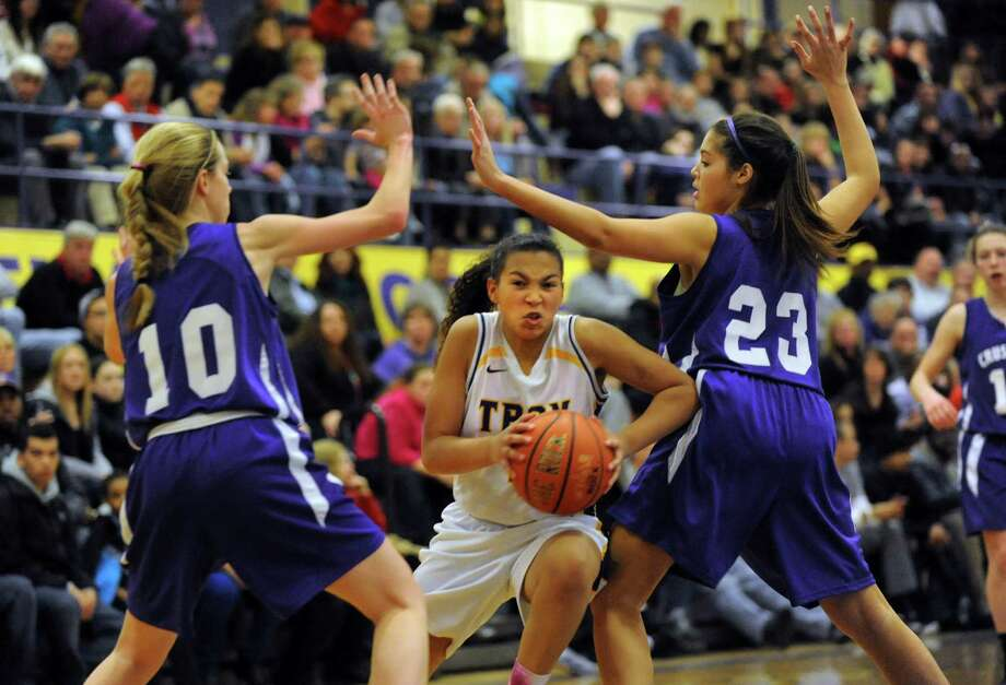 Troy's Kiana Patterson, center, works her way to the hoop as Catholic Central's Julia Engster, left, and Nakaela Elliot defend during their basketball game on Friday, Jan. 31, 2014, at Troy High in Troy, N.Y. (Cindy Schultz / Times Union) Photo: Cindy Schultz / 10025582A