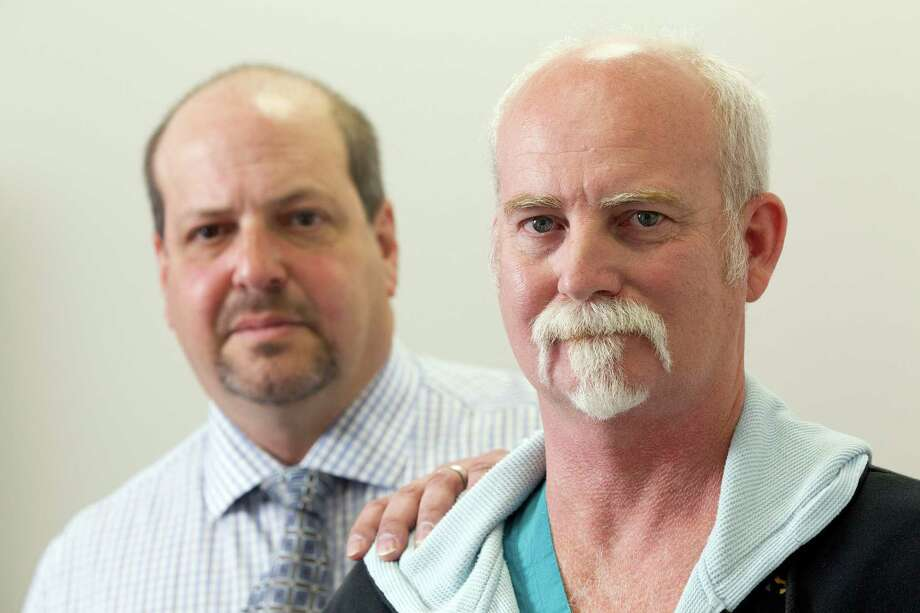 Mark Athans, right, with lawyer Gregg Rosenberg, said a noncompete agreement had blocked him from working as a surgical assistant in much of Texas. Photo: Johnny Hanson, Staff / © 2014  Houston Chronicle