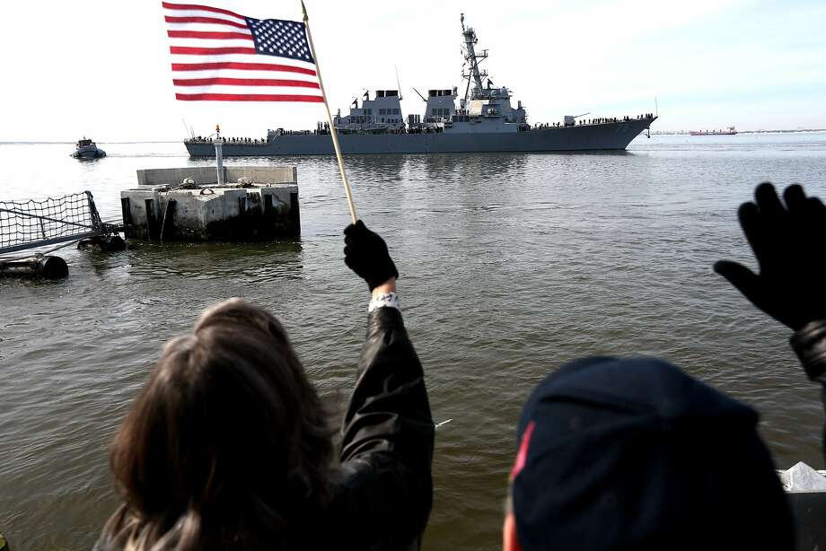 Lea and Rick Conway wave as the destroyer Donald Cook leaves Naval Station Norfolk for Rota, Spain on Friday, Jan. 31, 2014 in Norfolk, Va. The ship is the first of four destroyers to be stationed in Spain, part of a forward deployment to enhance the security of the European region. (AP Photo/The Virginian-Pilot, Steve Earley)  MAGS OUT Photo: Steve Earley, Associated Press