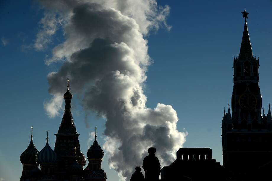 TOPSHOTS Smoke rises in the cold air above the Red Square in Moscow, on January 31, 2014. The temperatures in the Russian capital dropped today to -17 C (1 F), but due to high humidity and wind, weather experts said it would feel more like - 22 C (-8 F). AFP PHOTO / KIRILL KUDRYAVTSEVKIRILL KUDRYAVTSEV/AFP/Getty Images Photo: Kirill Kudryavtsev, AFP/Getty Images