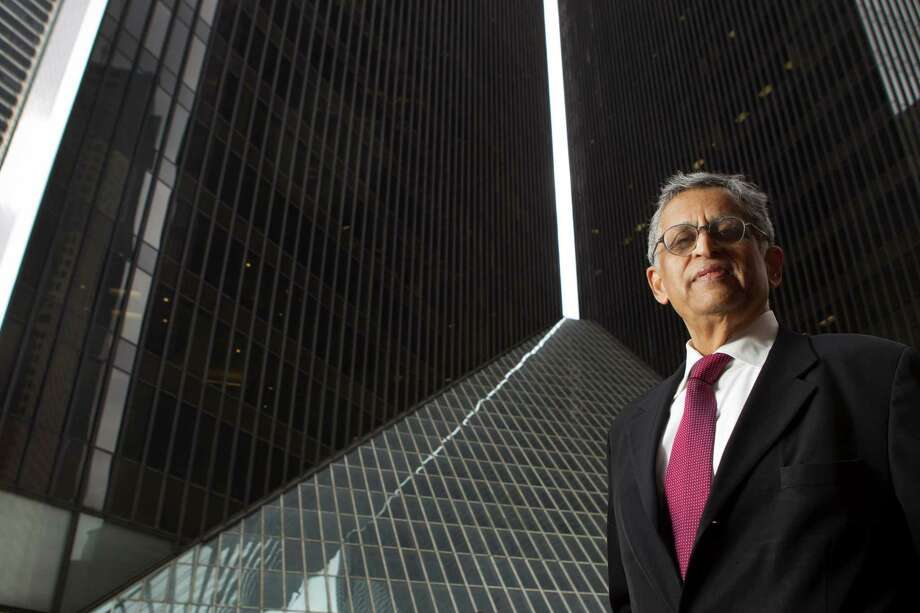 P.V. Banavalkar, principal of Vertika Structural engineers, has brought visions of skyscrapers to life around the nation. Photo: Brett Coomer, Staff / © 2014 Houston Chronicle