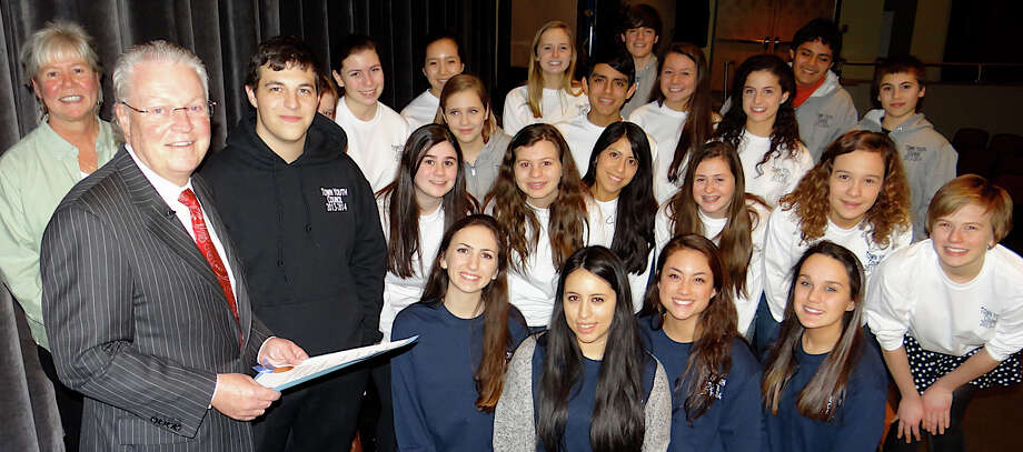 Parks and Recreation Program Coordinator Ginna Paules,  left, with First Selectman Michael Tetreau, forground, and members of the Town Youth Council at the concert benefiting the American Red Cross Philippines Typhoon Haiyan Relief efforts. The event took place Fridat night at Roger Ludlowe Middle School. Photo: Mike Lauterborn / Fairfield Citizen contributed