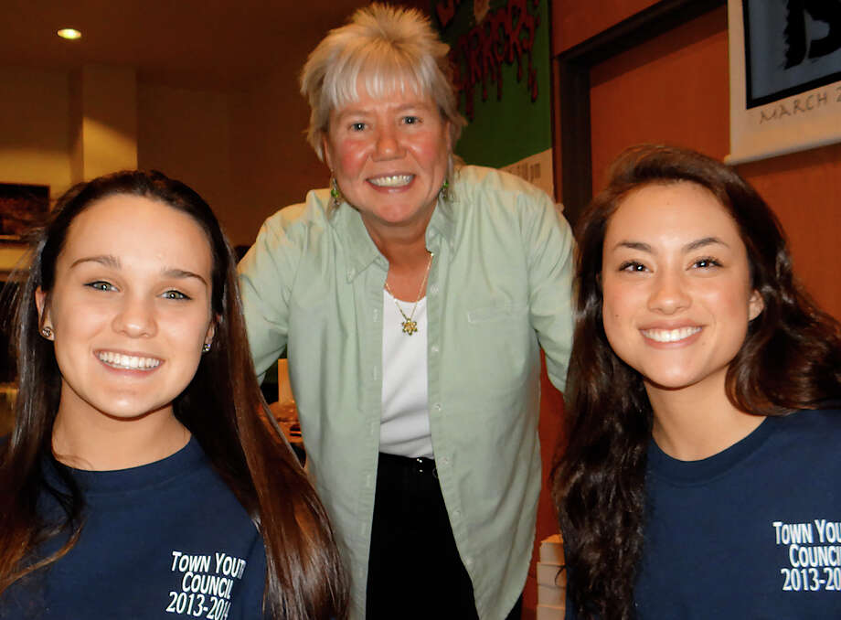 Parks and Recreation Program Coordinator Ginna Paules, center, with Town Youth Council members Hannah Morgan and Margeaux Hummerstone at concert Friday benefiting Philippine typhoon relief programs. Photo: Mike Lauterborn / Fairfield Citizen contributed