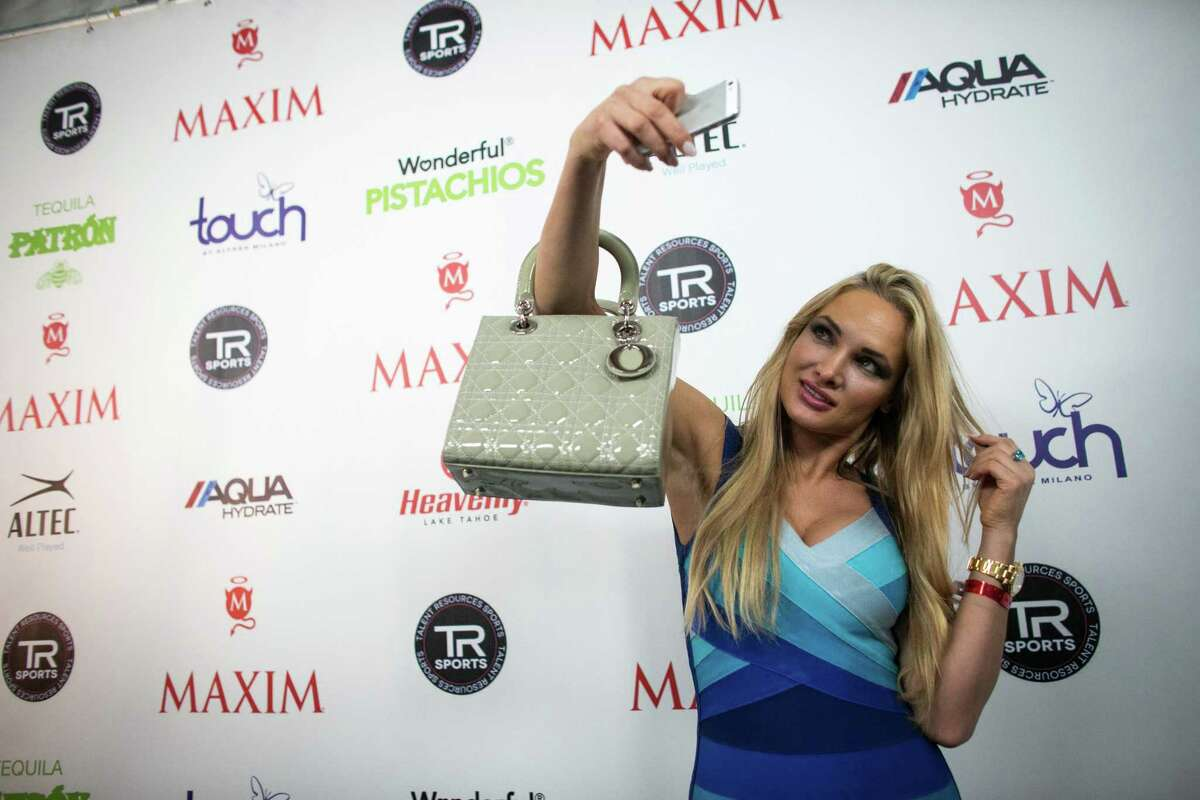 Model Kate Dros takes a selfie on the red carpet during the Maxim Super Bowl party on Saturday, February 1, 2014 at Espace on West 42nd Street in Manhattan. The party is one of many in the New York area in advance of the Super Bowl.