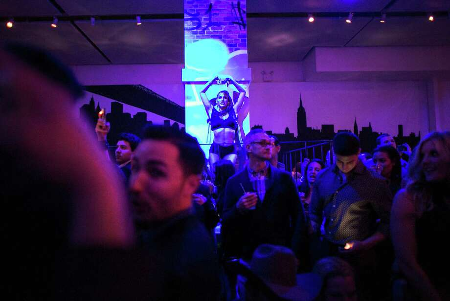 Guests pack into the venue during the Maxim Super Bowl party on Saturday, February 1, 2014 at Espace on West 42nd Street in Manhattan. The party is one of many in the New York area in advance of the Super Bowl. Photo: JOSHUA TRUJILLO, SEATTLEPI.COM / SEATTLEPI.COM