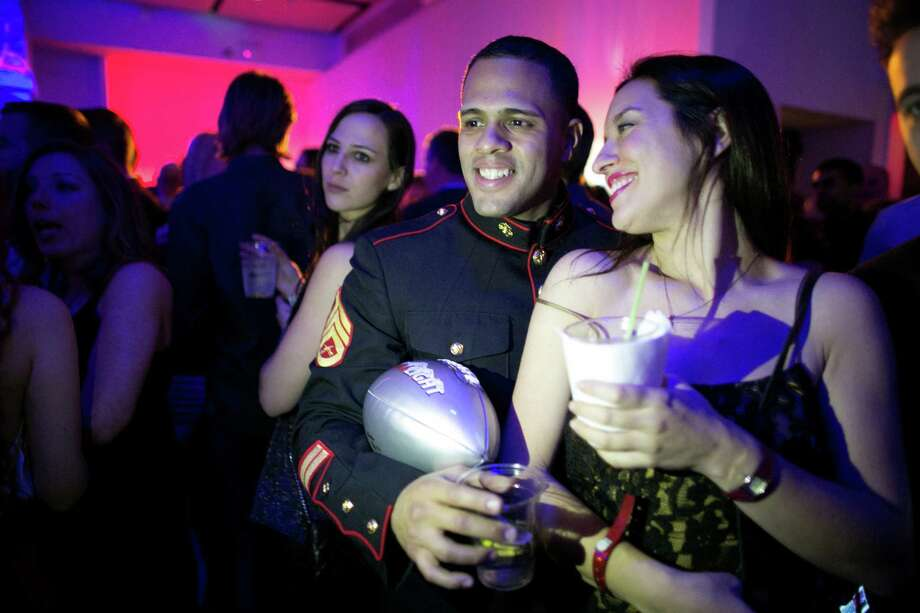 A U.S. Marine poses for a photo during the Maxim Super Bowl party on Saturday, February 1, 2014 at Espace on West 42nd Street in Manhattan. The party is one of many in the New York area in advance of the Super Bowl. Photo: JOSHUA TRUJILLO, SEATTLEPI.COM / SEATTLEPI.COM