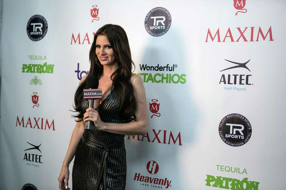 Maxim cover model April Rose gives a report from the red carpet during the Maxim Super Bowl party on Saturday, February 1, 2014 at Espace on West 42nd Street in Manhattan. The party is one of many in the New York area in advance of the Super Bowl. Photo: JOSHUA TRUJILLO, SEATTLEPI.COM / SEATTLEPI.COM