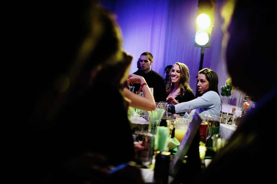 Drinks flow freely at an open bar at the MAXIM Super Bowl party Saturday, Feb.1, 2014, at Espace in New York City. Photo: JORDAN STEAD, SEATTLEPI.COM / SEATTLEPI.COM
