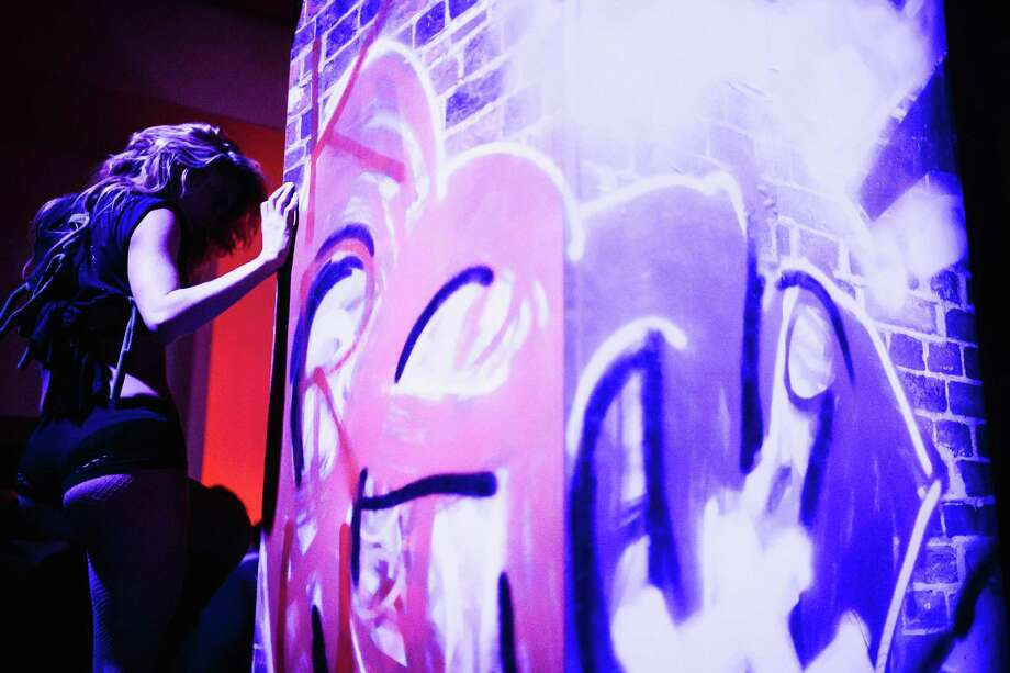 Women dance on raised platforms adorned with graffiti at the MAXIM Super Bowl party Saturday, Feb.1, 2014, at Espace in New York City. Photo: JORDAN STEAD, SEATTLEPI.COM / SEATTLEPI.COM