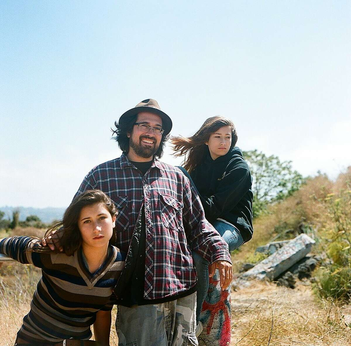 Tomas Moniz with daughters Zora (left) and Ella.