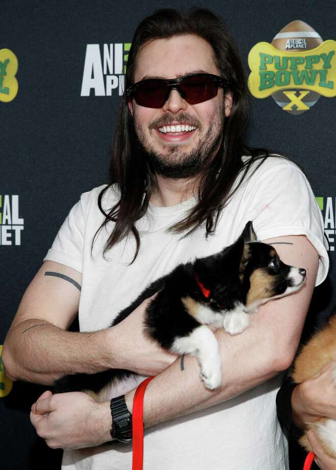 IMAGE DISTRIBUTED FOR DISCOVERY COMMUNICATIONS - Andrew W.K. of Animal Planet's Lil BUB's special special attends the Puppy Bowl X at the Discovery Times Square Experience in New York on Tuesday, Jan. 28, 2014. (Mark Von Holden/AP Images for Discovery Communications) Photo: Mark Von Holden, Associated Press / AP Images