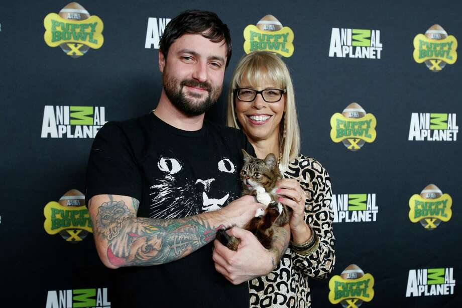 IMAGE DISTRIBUTED FOR DISCOVERY COMMUNICATIONS - Owner Mike Bridavsky, Lil BUB star of Animal Planet's Lil BUB's special special, and Animal Planet President Marjorie Kaplan attend the Puppy Bowl X at the Discovery Times Square Experience in New York on Tuesday, Jan. 28, 2014. (Mark Von Holden/AP Images for Discovery Communications) Photo: Mark Von Holden, Associated Press / AP Images