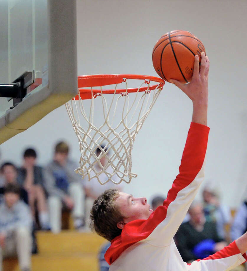 Alex Wolf of Greenwich during warm-ups prior to the start of the high school basketball game between Darien High School and Greenwich High School at Darien, Friday night, Jan. 31, 2014. Photo: Bob Luckey / Greenwich Time