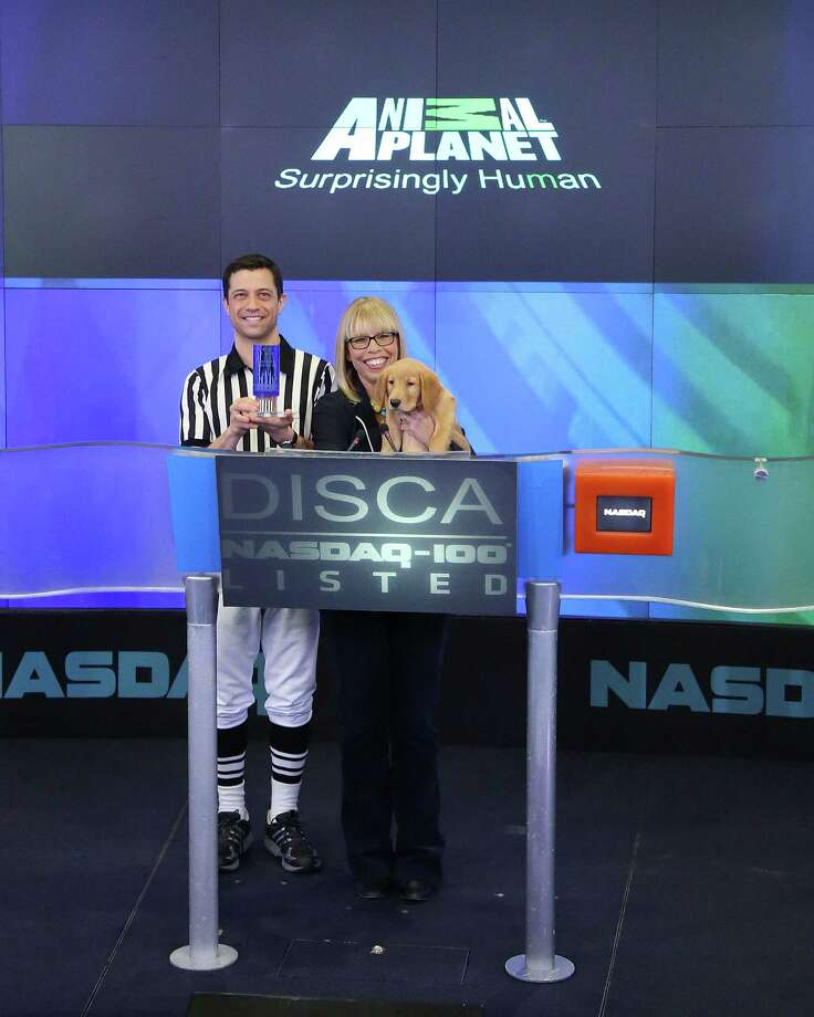 NEW YORK, NY - JANUARY 31:  Puppy Bowl referee Dan Schachner and Group President, Animal Planet, Science, and Velocity Marjorie Kaplan ring the closing bell in honor of Puppy Bowl at NASDAQ MarketSite on January 31, 2014 in New York City. Photo: Taylor Hill, Getty Images / 2014 Getty Images
