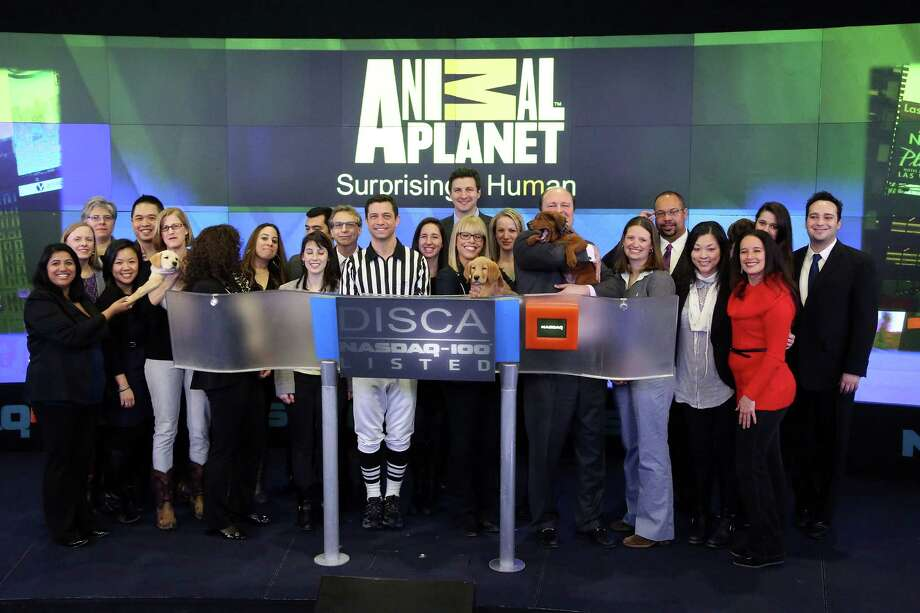 NEW YORK, NY - JANUARY 31:  Executives including Puppy Bowl referee Dan Schachner and group President, Animal Planet, Science, and Velocity Marjorie Kaplan ring the closing bell at NASDAQ MarketSite on January 31, 2014 in New York City. Photo: Taylor Hill, Getty Images / 2014 Getty Images