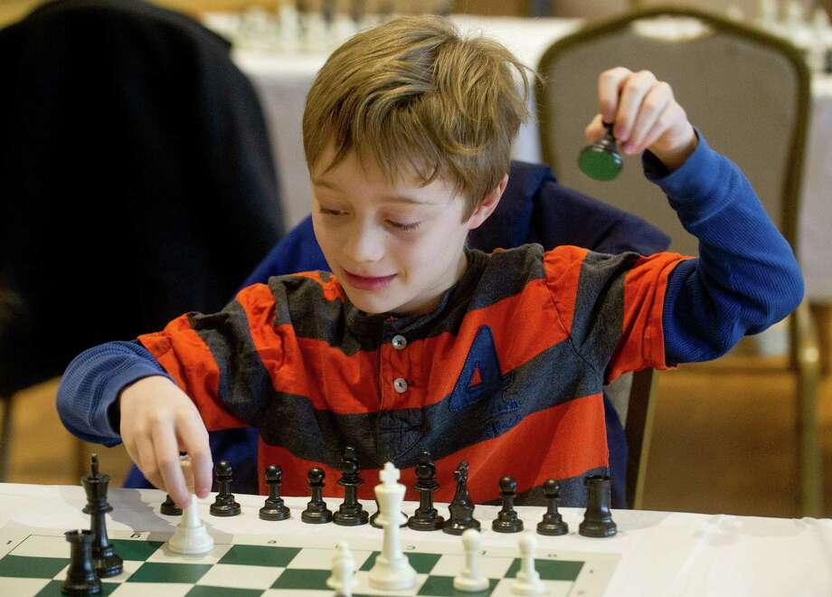 Theodore Bang plays chess during the National Educational Chess Association's tournament at the Italian Center in Stamford, Conn., on Saturday, February 1, 2014. Photo: Lindsay Perry / Stamford Advocate