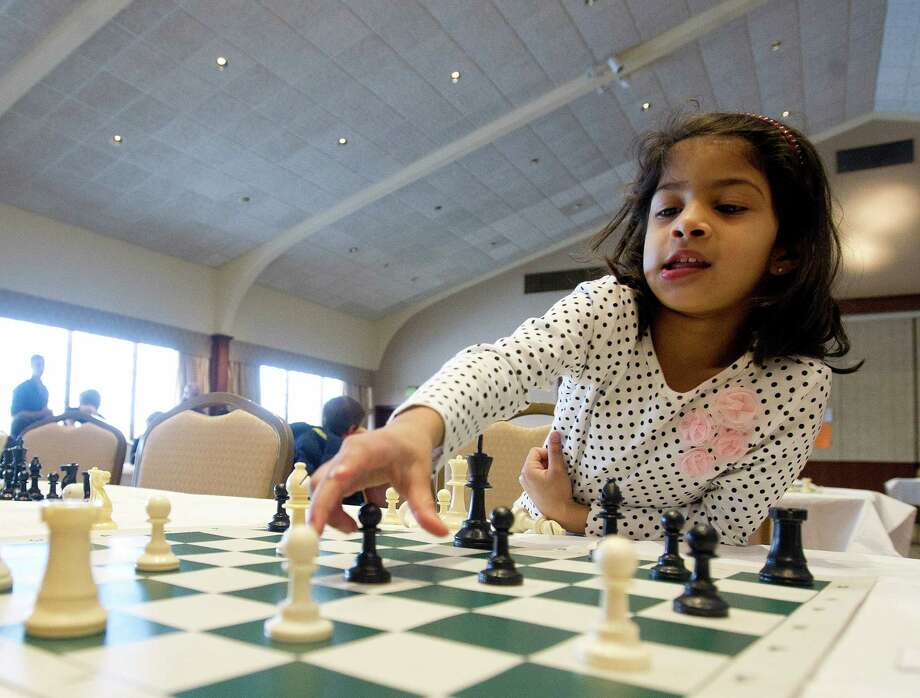 Vedha Kongettira plays a chess game during the National Educational Chess Association's tournament at the Italian Center in Stamford, Conn., on Saturday, February 1, 2014. Photo: Lindsay Perry / Stamford Advocate