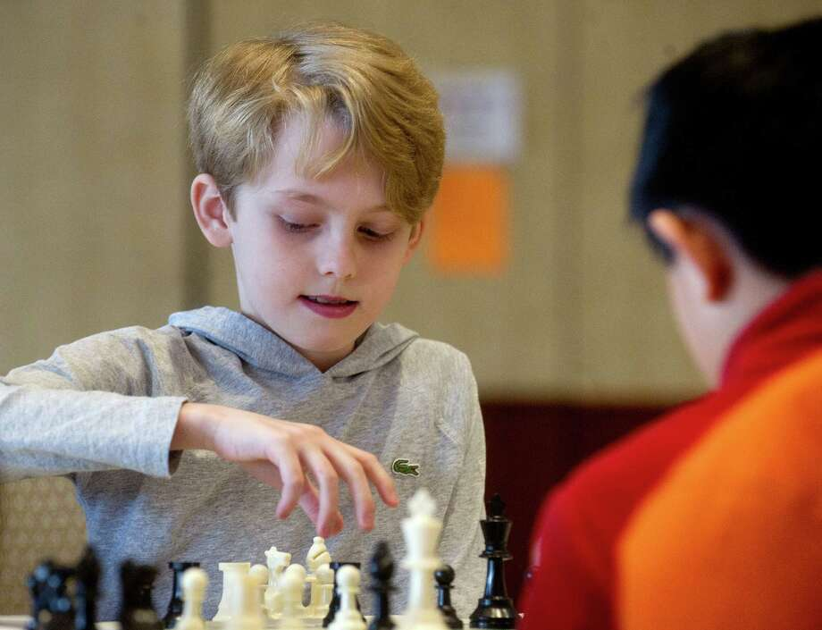 Jack Klein plays chess against Ethan Xia during the National Educational Chess Association's tournament at the Italian Center in Stamford, Conn., on Saturday, February 1, 2014. Photo: Lindsay Perry / Stamford Advocate