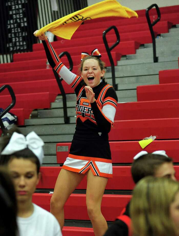 Ridgefield's Kristin NcKeown waves a towel at the finish of the 17th Annual 2014 FCIAC Cheerleading Competition at Fairfield Warde High School in Fairfield, Conn. on Saturday February 1, 2014. Photo: Christian Abraham / Connecticut Post