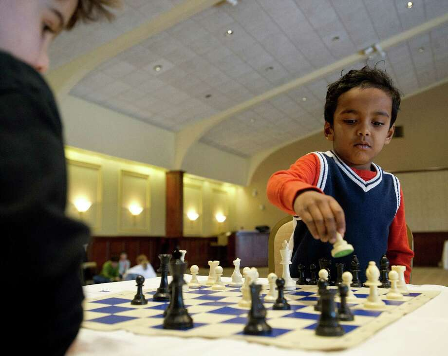Saharsh Bangaru, right, plays a match against Henry Graham during the National Educational Chess Association's tournament at the Italian Center in Stamford, Conn., on Saturday, February 1, 2014. Their match ended in a draw. Photo: Lindsay Perry / Stamford Advocate