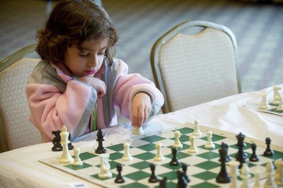 Julia Knispel plays chess during the National Educational Chess Association's tournament at the Italian Center in Stamford, Conn., on Saturday, February 1, 2014. Photo: Lindsay Perry / Stamford Advocate