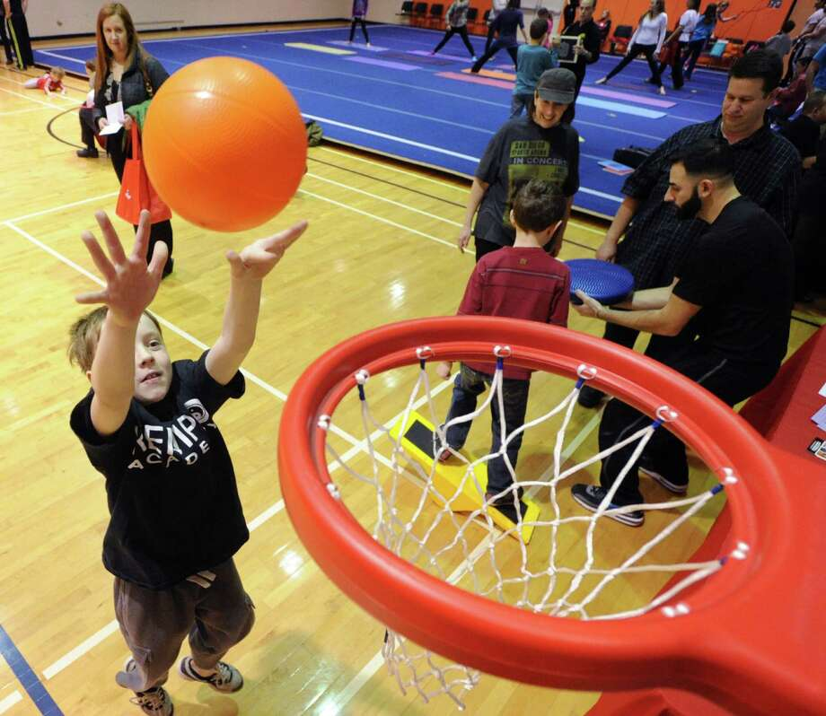 Gavin Boucher, 8, of Greenwich, sinks a basket during the Kids in the Kitchen Fit & Fun Fest at the YWCA of Greenwich, Saturday afternoon, Feb. 1, 2014. The event was sponsored by the Junior League of Greenwich to promote children's health. Photo: Bob Luckey / Greenwich Time
