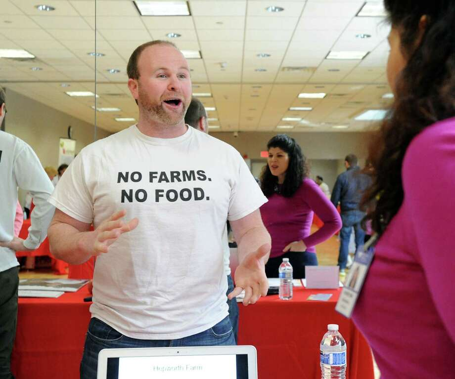 At left, Mike Geller, owner of Mike's Organic Delivery, speaks about nutrition during the Kids in the Kitchen Fit & Fun Fest at the YWCA of Greenwich, Saturday afternoon, Feb. 1, 2014. The event was sponsored by the Junior League of Greenwich to promote children's health. Photo: Bob Luckey / Greenwich Time